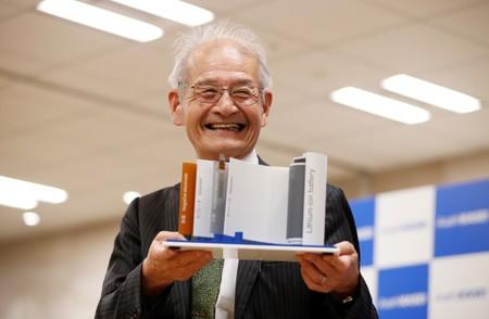 Asahi Kasei honorary fellow Akira Yoshino, 2019 Nobel Prize in Chemistry winner, holds a mock of lithium-ion battery during a news conference in Tokyo