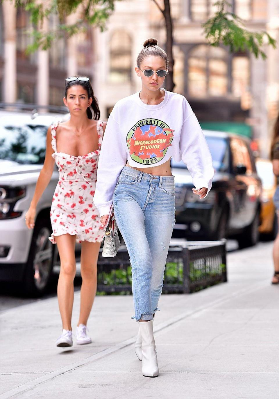 <p>G put a throwback spin on her signature crop top-jeans-booties equation. She rocked an old-school Nickelodeon Studios sweatshirt that my 9-year-old self would have killed for. </p>