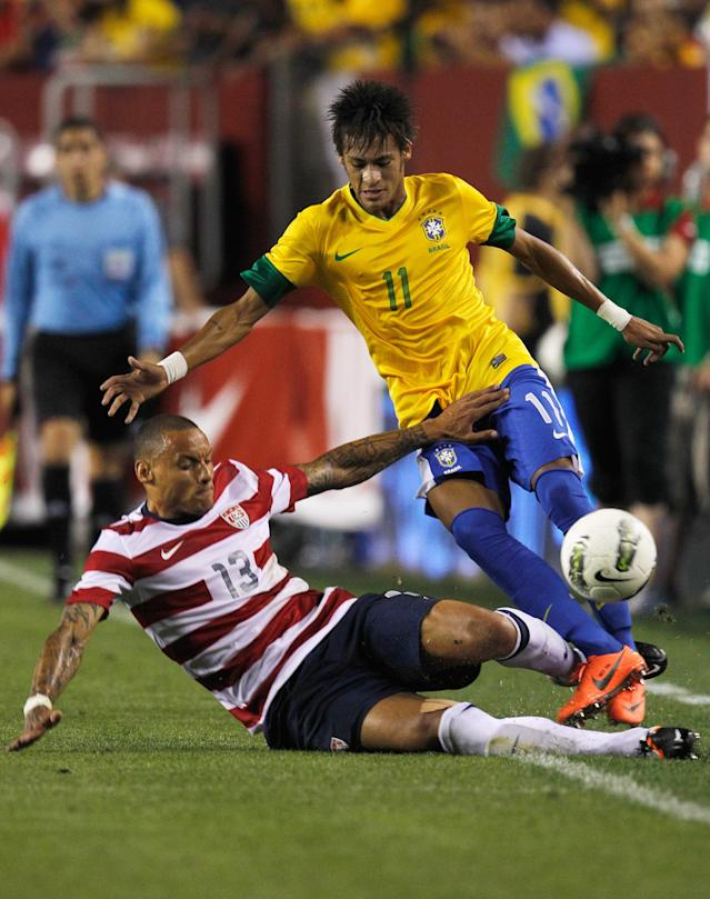 LANDOVER, MD - MAY 30: Neymar #11 of Brazil and Jermaine Jones #13 of USA collide going after the ball during an International friendly game at FedExField on May 30, 2012 in Landover, Maryland. (Photo by Rob Carr/Getty Images)