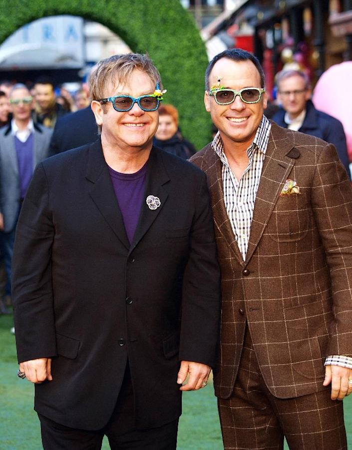 """British pop legend Elton John (L) has called for a boycott of Dolce and Gabbana after one of the designers behind the Italian fashion label condemned IVF babies as """"synthetic"""" (AFP Photo/Max Nash)"""