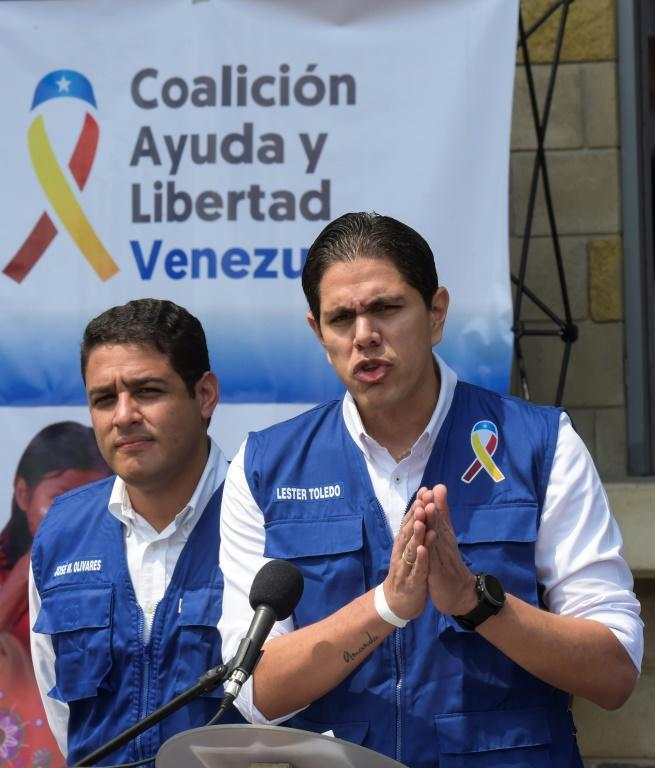 Lester Toledo (R), head of the team appointed to distribute the aid, gives a press conference in Cucuta, Colombia