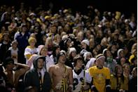<p>Students at an Iowa high school show up to support their football team during a game held on Halloween. </p>