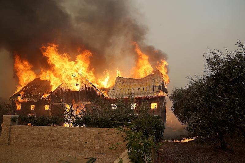 Fire consumes a barn as an out of control wildfire moves through the area on Oct. 9, 2017, in Glen Ellen, California. (Justin Sullivan via Getty Images)
