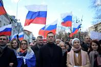 Navalny, his wife Yulia, opposition politician Lyubov Sobol and other demonstrators march in memory of murdered Kremlin critic Boris Nemtsov in downtown Moscow in February 2020