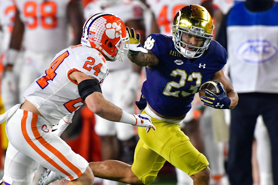Running back Kyren Williams of the Notre Dame Fighting Irish stiff-arms safety Nolan Turner of the Clemson Tigers on Nov. 7. (Matt Cashore-Pool/Getty Images)