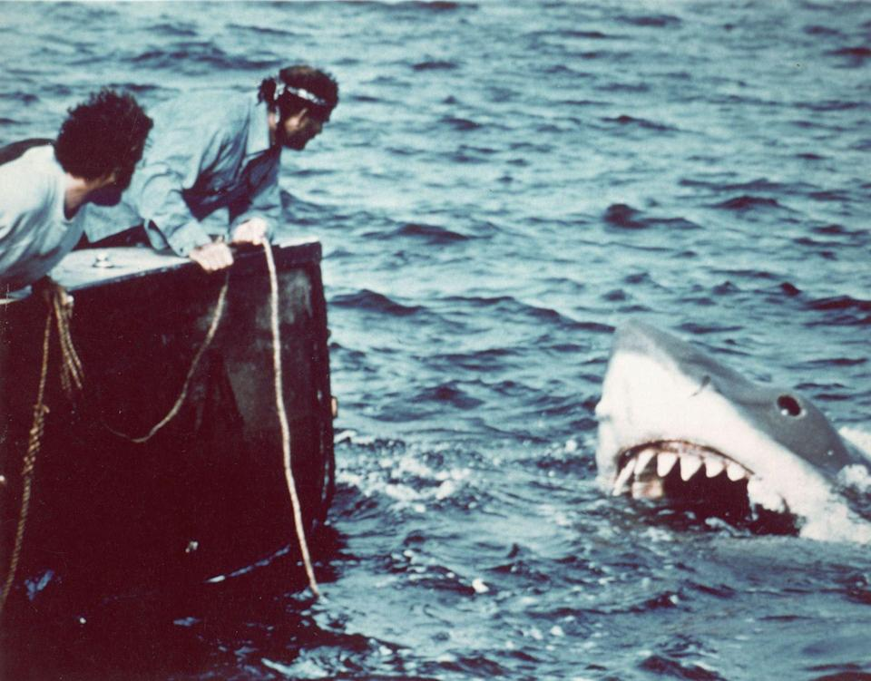 """<p>Since the summer of 1975, Martha's Vineyard has drawn crowds of beachgoers, yes, as well as cinephiles thanks to Steven Spielberg's iconic film <em>Jaws </em>being filmed there. Not only was the movie a box office phenomenon, it has been heralded as <a href=""""https://collider.com/why-ive-seen-jaws-over-100-times/#:~:text=But%20the%20invisibility%20of%20the,theme%20to%20establish%20its%20presence."""" rel=""""nofollow noopener"""" target=""""_blank"""" data-ylk=""""slk:the start of a new era"""" class=""""link rapid-noclick-resp"""">the start of a new era</a> in films. </p>"""