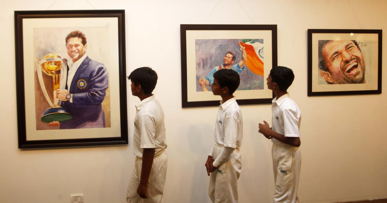 MUMBAI, INDIA - JANUARY 4: An exhibition of over 25 paintings portraying different moods and expressions of cricket legend Sachin Tendulkar by artist Ashok Karnik was inagurated by Mayor of Mumbai Sunil Prabhu at Andheri Sports Club, Andheri on January 4, 2014 in Mumbai, India. Ashok Karnik said he will pay his tributes to the iconic batsman through a series of vibrant water colour paintings. The exhibition, named 'Portraits of Sachin' (Sachin in Emotional Colours), would be held till January 12. (Photo by Vidya Subramanian/Hindustan Times via Getty Images)