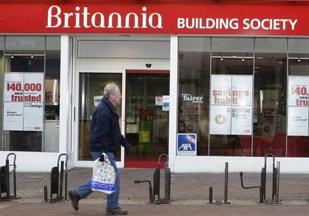 A pedestrian walks past the Britannia Building Society, in Northampton, central England January 21, 2009. REUTERS/Darren Staples
