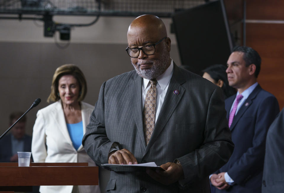 FILE - In this July 1, 2021, file photo Rep. Bennie Thompson, chairman of the House Homeland Security Committee, flanked by Speaker of the House Nancy Pelosi, D-Calif., left, and Rep. Pete Aguilar, D-Calif., finishes his remarks as Pelosi announces her appointments to a new select committee to investigate the violent Jan. 6 insurrection at the Capitol, on Capitol Hill in Washington. (AP Photo/J. Scott Applewhite, File)