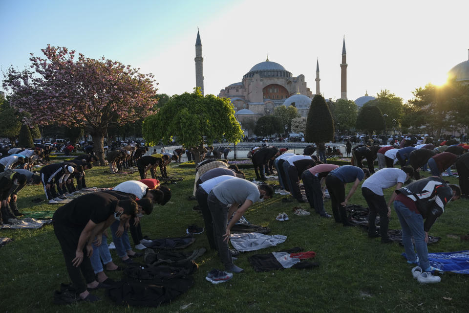 Muslims offer prayers during the first day of Eid al-Fitr, which marks the end of the holy month of Ramadan, outside the Byzantine-era Hagia Sophia, currently a mosque, in the historic Sultanahmet district of Istanbu byzantine-era Hagia Sophia in Istanbul, Thursday, May 13, 2021. Hundreds of Muslims attended dawn Eid al-Fitr prayers marking the end of the holy month of Ramadan, for the first time since the sixth-century structure, also an UNESCO World Heritage site, was reconverted into a mosque. (AP Photo)