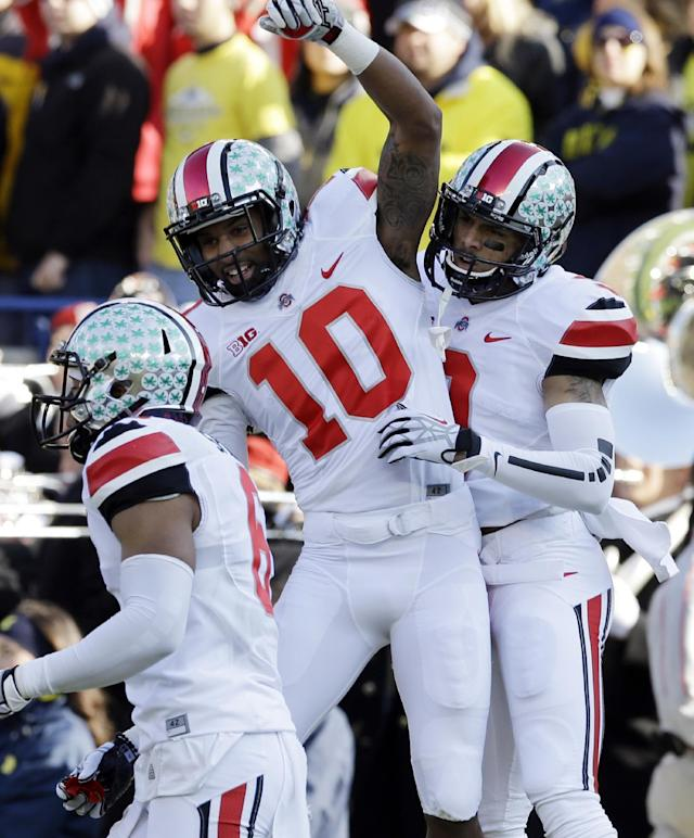 Ohio State wide receiver Devin Smith, right, and wide receiver Philly Brown (10) celebrate Smith's touchdown during the first quarter of an NCAA college football game against Michigan in Ann Arbor, Mich., Saturday, Nov. 30, 2013. (AP Photo/Carlos Osorio)