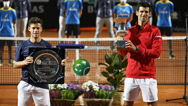 Diego Schwartzman and Novak Djokovic, pictured here with their respective trophies after the Italian Open final.