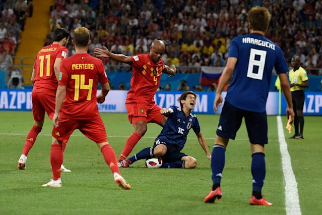 <p>Belgium's defender Vincent Kompany (3rd-L) vies for the ball with Japan's forward Yuya Osako (2nd-R) during the Russia 2018 World Cup round of 16 football match between Belgium and Japan at the Rostov Arena in Rostov-On-Don on July 2, 2018. (Photo by JUAN BARRETO / AFP) </p>