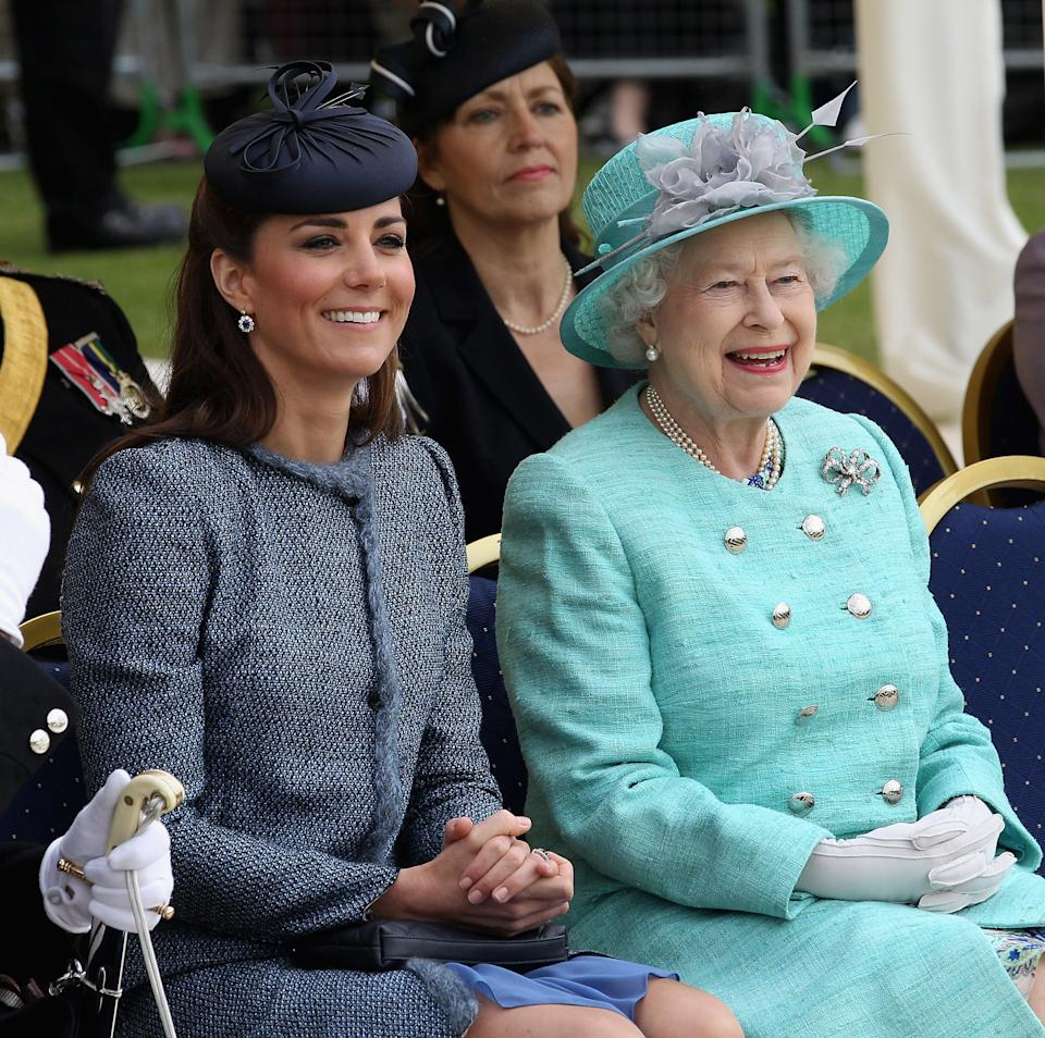 Catherine, Duchess of Cambridge and Queen Elizabeth II smile as they visit Vernon Park during a Diamond Jubilee visit to Nottingham on June 13, 2012 in Nottingham, England.