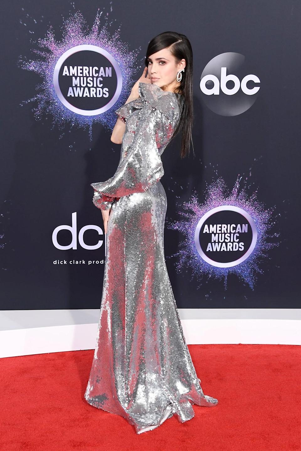 <p>The actress's shimmery silver dress looked striking from every angle.</p>