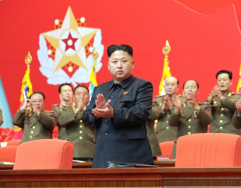 North Korean leader Kim Jong Un applauds during the second meeting of security personnel of the Korean People's Army (KPA) at April 25 House of Culture in this undated photo released by North Korea's Korean Central News Agency (KCNA) in Pyongyang November 22, 2013. REUTERS/KCNA/Handout via Reuters (NORTH KOREA - Tags: POLITICS MILITARY)   ATTENTION EDITORS - THIS PICTURE WAS PROVIDED BY A THIRD PARTY. REUTERS IS UNABLE TO INDEPENDENTLY VERIFY THE AUTHENTICITY, CONTENT, LOCATION OR DATE OF THIS IMAGE. FOR EDITORIAL USE ONLY. NOT FOR SALE FOR MARKETING OR ADVERTISING CAMPAIGNS. THIS PICTURE IS DISTRIBUTED EXACTLY AS RECEIVED BY REUTERS, AS A SERVICE TO CLIENTS. NO THIRD PARTY SALES. NOT FOR USE BY REUTERS THIRD PARTY DISTRIBUTORS. SOUTH KOREA OUT. NO COMMERCIAL OR EDITORIAL SALES IN SOUTH KOREA