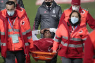 Real Madrid's Rodrygo is carried off the pitch with an injury during the Spanish La Liga soccer match between Real Madrid and Granada at the Alfredo Di Stefano stadium in Madrid, Spain, Wednesday, Dec. 23, 2020. (AP Photo/Bernat Armangue)