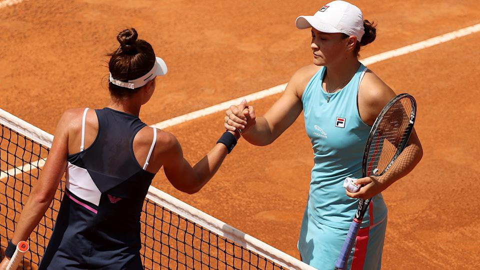 Ash Barty and Veronika Kudermetova, pictured here after their clash at the Italian Open.