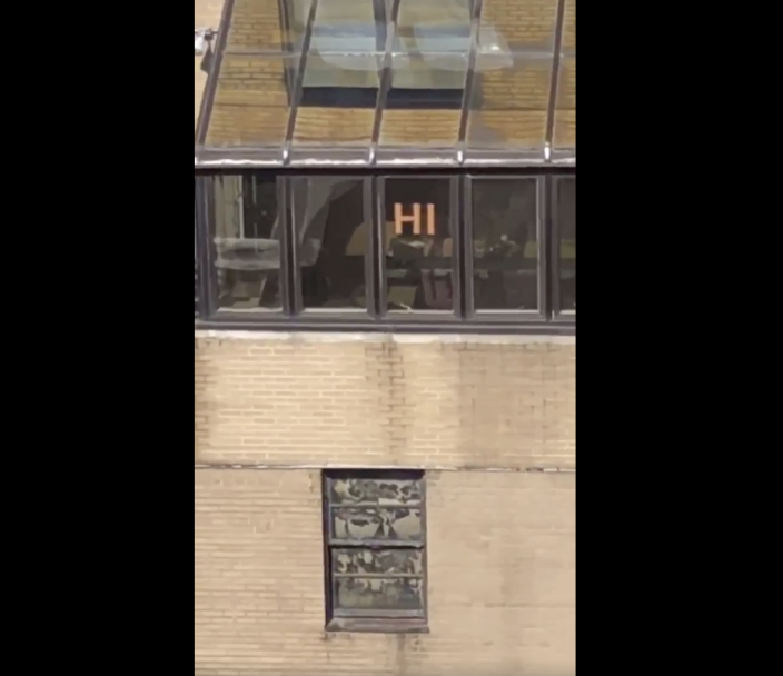 Two New York City neighbors communicated by posting messages on the windows of their respective buildings and formed a beautiful friendship in the process. (Screenshot: Courtesy of Lilian Kogan)