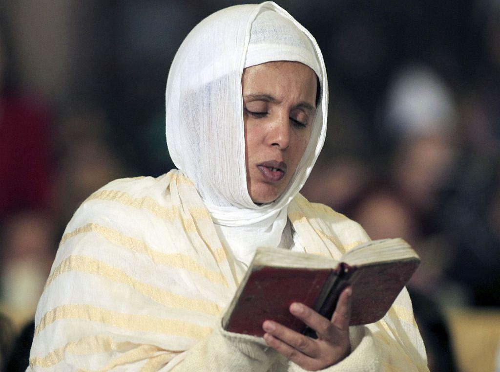 CAIRO: A Coptic Christian reads the bible during the Coptic Christmas eve mass led by Pope Tawadros II, the 118th Pope of the Coptic Orthodox Church of Alexandria and Patriarch of the See of St. Mark Cathedral, in Cairo January 6, 2013.