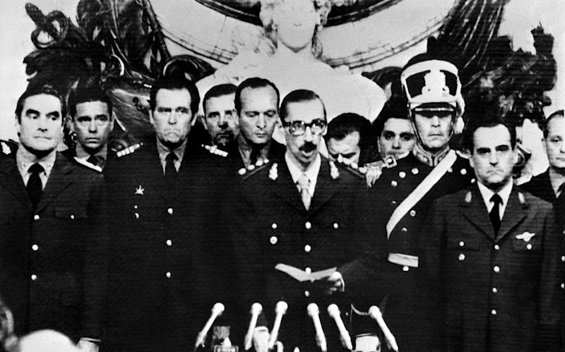 Lieutenant General Jorge Rafael Videla (center) takes an oath of office in 1976 after leading a coup in Argentina