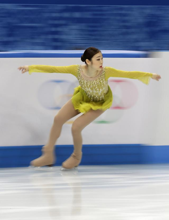 Yuna Kim of South Korea competes in the women's short program figure skating competition at the Iceberg Skating Palace during the 2014 Winter Olympics, Wednesday, Feb. 19, 2014, in Sochi, Russia