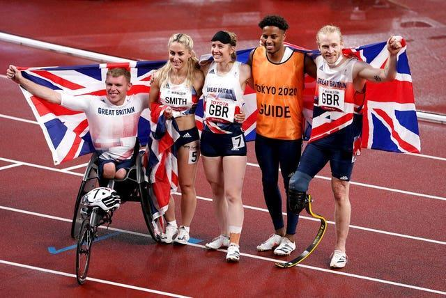 Great Britain's (left-right) Nathan Maguire, Ali Smith, Libby Clegg, guide Chris Clarke and Jonnie Peacock after winning bronze in the universal 4x100m