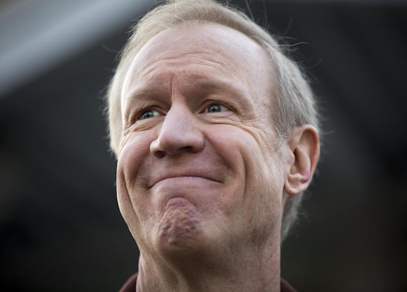 Illinois Republican gubernatorial candidate Bruce Rauner answers questions after voting on Tuesday, March 18, 2014, in Winnetka, Ill. Rauner faces State Sen. Bill Brady, State Sen. Kirk Dillard and State Treasurer Dan Rutherford in the primary election. (AP Photo/Andrew A. Nelles)