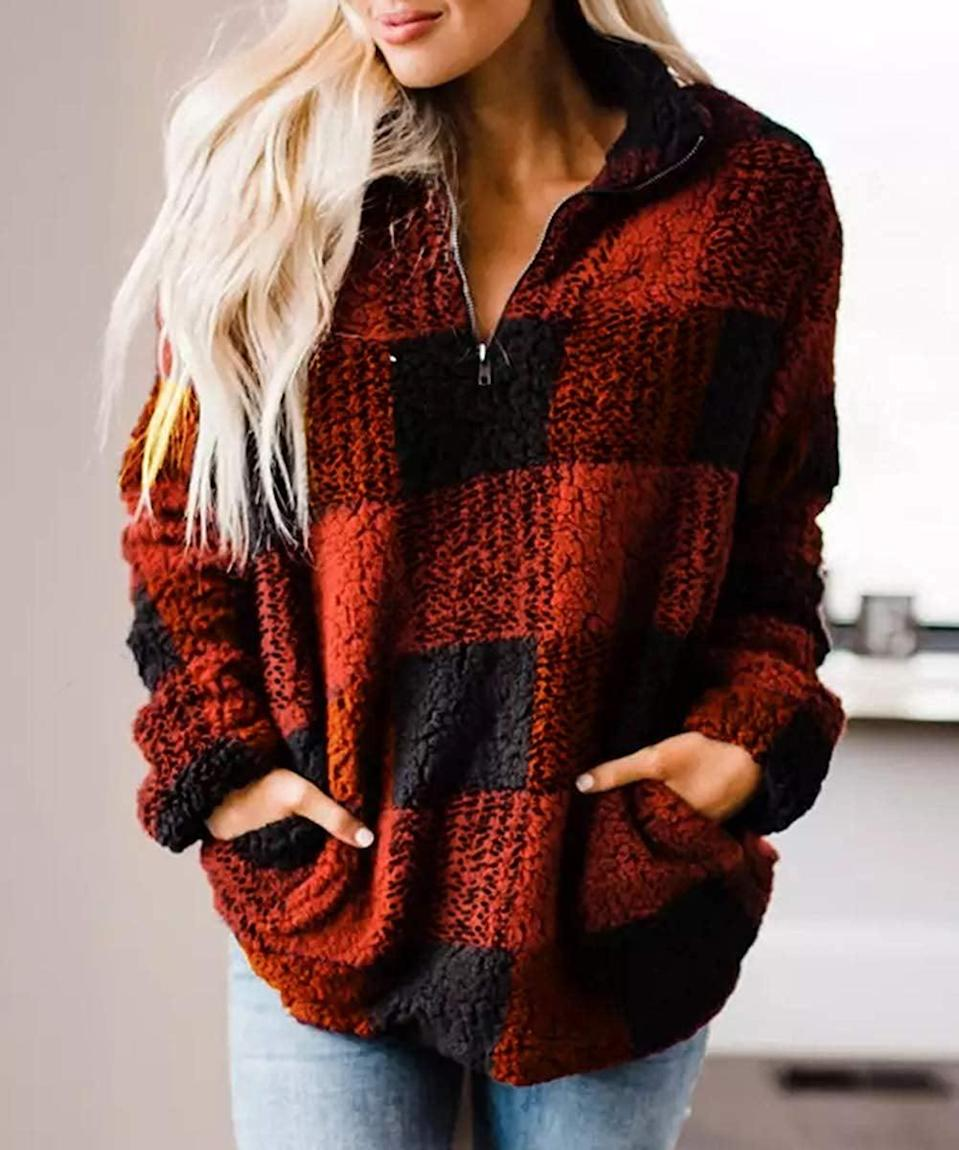 """<p>For relaxing weekends, wear this <a href=""""https://www.popsugar.com/buy/Zesica-Plaid-Sherpa-Fleece-Sweatshirt-512892?p_name=Zesica%20Plaid%20Sherpa%20Fleece%20Sweatshirt&retailer=amazon.com&pid=512892&price=37&evar1=fab%3Aus&evar9=46859993&evar98=https%3A%2F%2Fwww.popsugar.com%2Ffashion%2Fphoto-gallery%2F46859993%2Fimage%2F46860972%2FZesica-Plaid-Sherpa-Fleece-Sweatshirt&list1=shopping%2Camazon%2Choliday%2Cwinter%20fashion%2Choliday%20fashion%2C50%20under%20%2450%2Cgifts%20for%20women%2Caffordable%20shopping&prop13=mobile&pdata=1"""" rel=""""nofollow noopener"""" class=""""link rapid-noclick-resp"""" target=""""_blank"""" data-ylk=""""slk:Zesica Plaid Sherpa Fleece Sweatshirt"""">Zesica Plaid Sherpa Fleece Sweatshirt </a> ($37).</p>"""