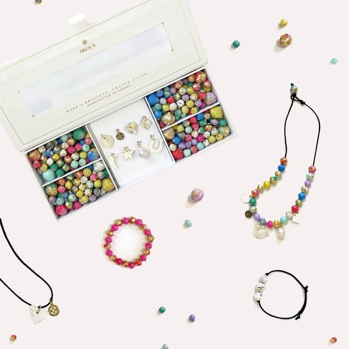 "<h3><a href=""https://akola.co/collections/just-in/products/anasa-necklace-and-bracelet-kit-with-gold-foil-rainbow-toned-karatasi-beads"" rel=""nofollow noopener"" target=""_blank"" data-ylk=""slk:Akola Anasa DIY Necklace and Bracelet Kit"" class=""link rapid-noclick-resp"">Akola Anasa DIY Necklace and Bracelet Kit</a></h3><br>For the woman who's been flexing that DIY muscle over the past few months, this luxe bead kit will elevate her creativity to new heights. Think hand-rolled Karatasi beads embellished with a gold foil appliqué, an assortment of hand-carved horn charms, baroque pearl charms, and more to work with. <br><br><strong>Akola</strong> Anasa DIY Necklace and Bracelet Kit, $, available at <a href=""https://go.skimresources.com/?id=30283X879131&url=https%3A%2F%2Fakola.co%2Fcollections%2Fjust-in%2Fproducts%2Fanasa-necklace-and-bracelet-kit-with-gold-foil-rainbow-toned-karatasi-beads"" rel=""nofollow noopener"" target=""_blank"" data-ylk=""slk:Akola"" class=""link rapid-noclick-resp"">Akola</a>"