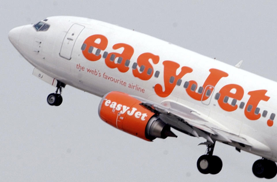 """FILE- An easyJet aircraft takes off from Ciampino airport in Rome, Italy, in this Aug. 30, 2004, file photo.  London-based budget airline EasyJet has announced it is opening a base in Vienna in anticipation of Brexit. EasyJet, which runs budget flights throughout Europe, said in a statement Friday July 14, 2017 that it will open a European Union base in Austria's capital """"regardless of the outcome of talks on a future UK-EU aviation agreement."""" (AP Photo/Corrado Giambalvo/File)"""