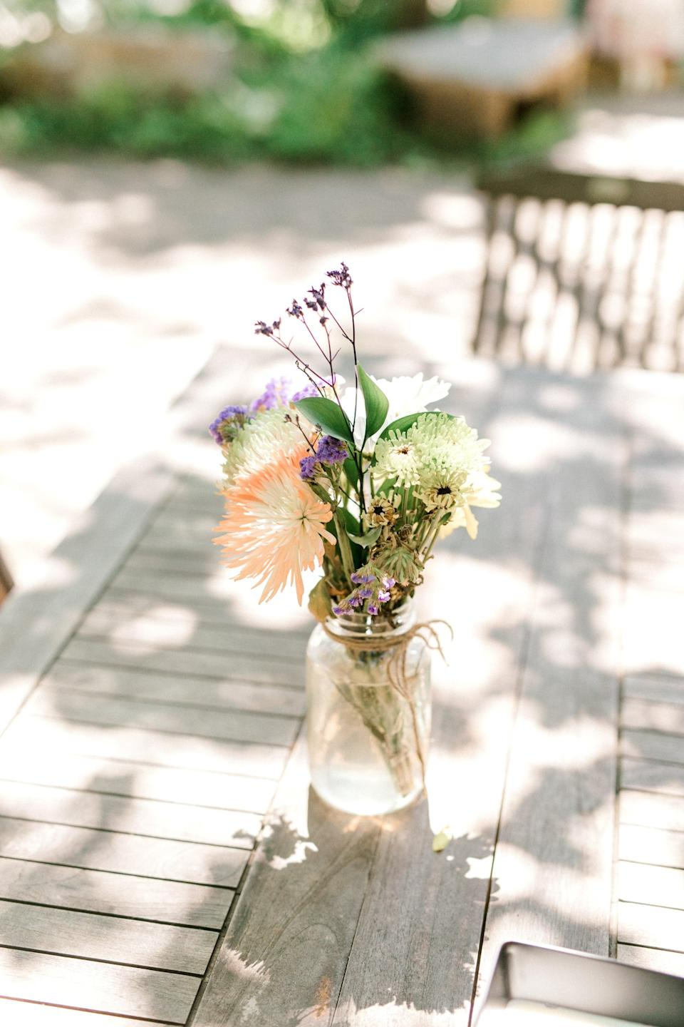<p>Want to add a tasteful touch to your special day? Decorate your venue with cute, flower-filled mason jars. Just add a little wire or ribbon around the top of each jar, fill them with flowers and water, and you just made the prettiest arrangements of all.</p>