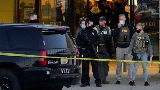 PHOTO: FBI officials and police stand outside the Mayfair Mall after a shooting, Friday, Nov. 20, 2020, in Wauwatosa, Wis. (Nam Y. Huh/AP)