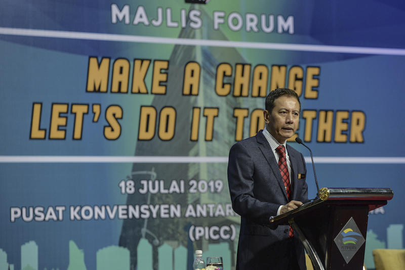 Election Commission chairman Azhar Azizan Harun delivers his speech during the 'Make A Change, Let's Do It Together' in Putrajaya July 18, 2019. — Picture by Shafwan Zaidon