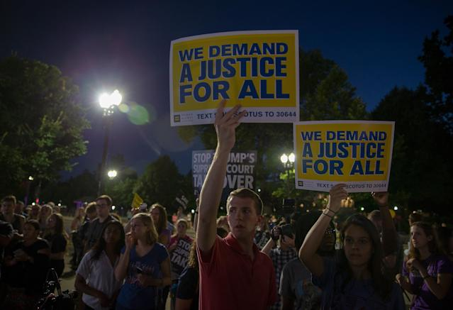 <p>Pro-choice and anti-abortion protesters demonstrate in front of the U.S. Supreme Court on July 9, 2018 in Washington, D.C. (Photo: Tasos Katopodis/Getty Images) </p>