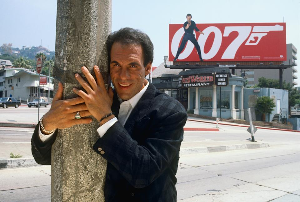 """WEST HOLLYWOOD, CA - 1988:  Actor Robert Davi poses on Sunset Blvd during a 1988 West Hollywood, California, photo portrait session. Davi plays a Colombian drug lord in the 1989 James Bond movie """"Licence to Kill."""" (Photo by George Rose/Getty Images)"""