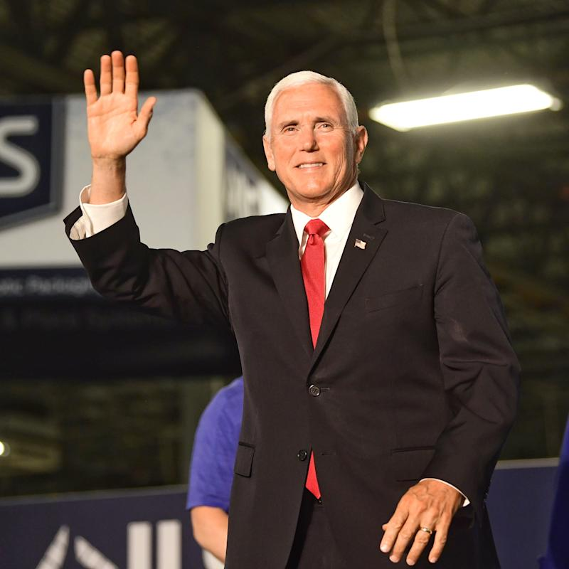 Vice President Mike Pence waves to the crowd as he approaches the podium at JLS Automation in Springettsbury Township to talk about the president's proposed trade plans, June 6, 2019.