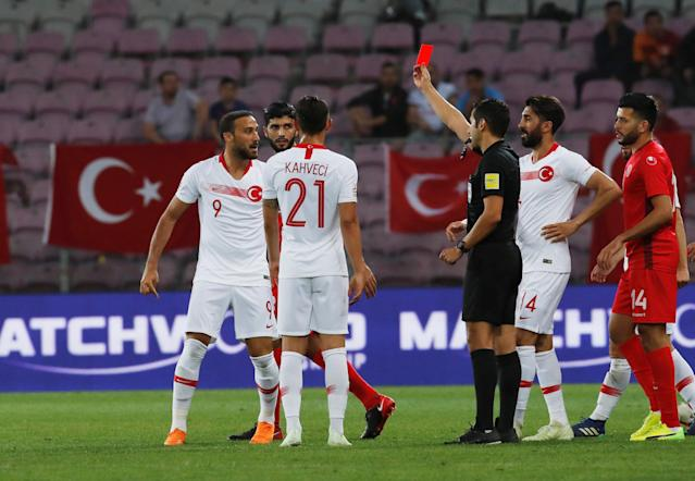 Soccer Football - International Friendly - Tunisia vs Turkey - Stade de Geneve, Geneva, Switzerland - June 1, 2018 Turkey's Cenk Tosun is shown a red card by the referee REUTERS/Denis Balibouse