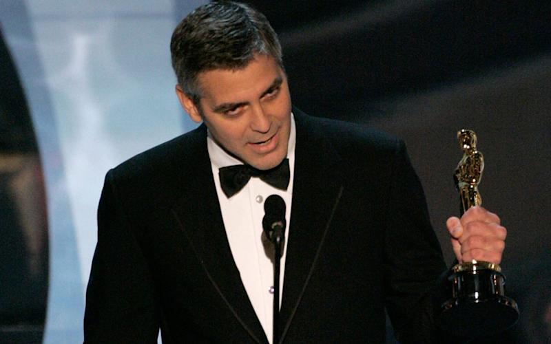 Clooney accepting the Best Supporting Actor Oscar in 2006 - Getty Images North America