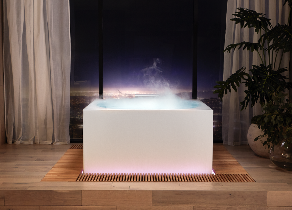 <p>Even if you swear you're not a bath person, this Stillness Bath from Kohler will change your mind. The two foot deep tub is a full submersion experience into complete and utter zen. While you can purchase this as a simple standalone soaker tub, the real effects come by adding in the Experience Tower—complete with light, aromatherapy and yes, fog...because that is clearly necessary to feeling like you're not in your bathroom. To take it one step further, an infinity overflow (yes, like an infinity pool) goes over the sides of the tub into water grates that get reheated and recirculated into your bath. I'm going to need to knock some walls to make room for this, but sign me up! Available late 2021. </p>