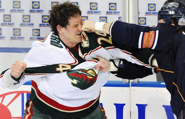 FILE - This Jan. 30, 2009, file photo shows Minnesota Wild left wing Derek Boogaard (24) getting hit by Edmonton Oilers left wing Steve MacIntyre (33) in a fight during first period NHL hockey action in Edmonton, Canada. In several player polls, Boogaard was voted as the league's most intimidating player. He was only 28 when he died of an accidental overdose of pain medication and alcohol. (AP Photo/The Canadian Press, Jimmy Jeong, File)