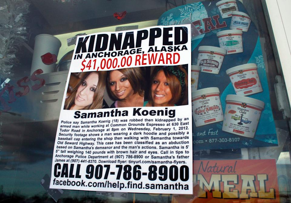 <p>A missing person poster for Samantha Koenig is displayed on the window of the coffee shop from which Keyes abducted her in Alaska</p>AP/Mark Thiessen