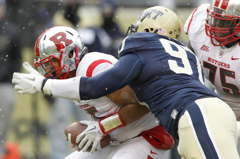 Pittsburgh defensive lineman Aaron Donald (97) sacks Rutgers quarterback Gary Nova (15) in the second quarter of an NCAA college football game on Saturday, Nov. 24, 2012 in Pittsburgh. (AP Photo/Keith Srakocic)