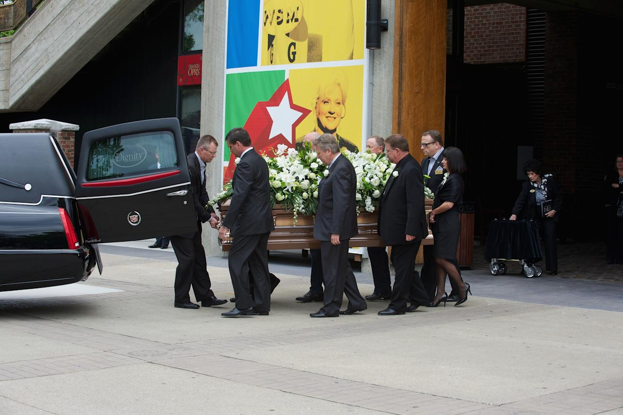 NASHVILLE, TN - MAY 02:  Pallbearers  load the casket at the funeral service for George Jones at The Grand Ole Opry on May 2, 2013 in Nashville, Tennessee. Jones passed away on April 26, 2013 at the age of 81.  (Photo by Jason Davis/Getty Images)