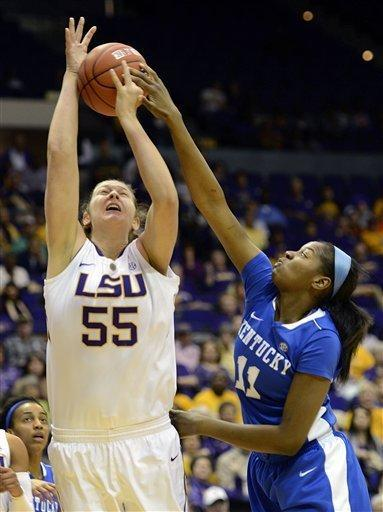 Kentucky center DeNesha Stallworth (11) gets a hand on the ball to block the shot of LSU forward Theresa Plaisance (55) during the first half of an NCAA college basketball game in Baton Rouge, La., Sunday, Feb. 24, 2013. (AP Photo/Bill Feig)