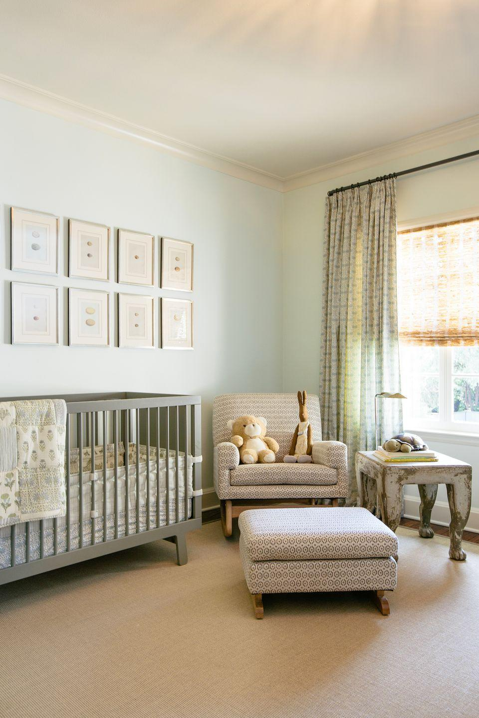 """<p>This nursery designed by <a href=""""https://www.jeanliudesign.com/"""" rel=""""nofollow noopener"""" target=""""_blank"""" data-ylk=""""slk:Jean Liu"""" class=""""link rapid-noclick-resp"""">Jean Liu</a> is a masterclass in unique and unexpected (yet still neutral) color schemes. Pastel mint green walls, curtains, and bedding keep things crisp and fresh and match nicely with the gray accents, while the pale olive green crib speaks to the warmer camel and creams tones throughout. </p>"""