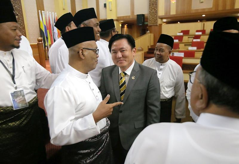 Perak DAP assemblyman Paul Yong banters with Opposition assemblymen at the State Legislative Assembly in the State Secretariat Building in Ipoh November 15, 2019. — Picture by Farhan Najib