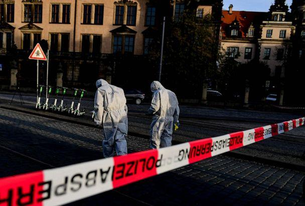 PHOTO: Police Forensics officers investigate the area near the Dresden Castle, in Dresden, Germany, Nov. 25, 2019, after a robbery of the Dresden Treasury Green Vault. (Filip Singer/EPA via Shutterstock)
