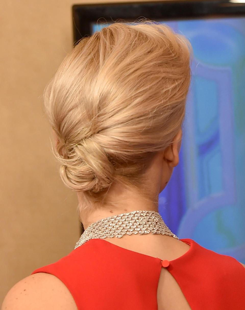 <p>For the 2016 Golden Globes, Jennifer swept her hair up into a knotted bun. [Photo: Getty] </p>