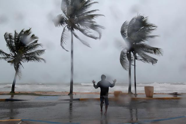<p>A man reacts in the winds and rain as Hurricane Irma slammed across islands in the northern Caribbean on Wednesday, in Luquillo, Puerto Rico, Sept. 6, 2017. (Photo: Alvin Baez/Reuters) </p>